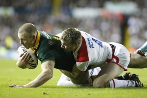 Australia's Luke Lewis, left, is tackled by England's Michael Shenton during their Four Nations Final rugby league match. AP Photo/Jon Super)