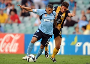 Sydney FC's Steve Corica (left) is tackled by Matthew Crowell of the Central Coast Mariners FC in their round 19 match in Sydney on Wednesday, Dec. 23, 2009. (AAP Image/Paul Miller)